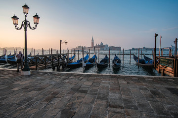 Venice, Italy, September 17, 2018 - Tourist take pictures sunrise on the waterfront next to the Doge Palace