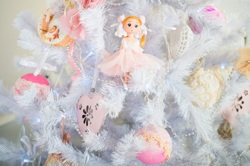 The morning before Xmas. New year holiday. Happy new year. Merry Christmas and Happy Holidays. Christmas. Beautiful decorated tree with toys. Christmas composition. Last preparations