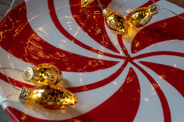 Christmas red and white swirl design with gold lights background