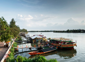 tourist restaurant boats at riverside in central kampot town cambodia
