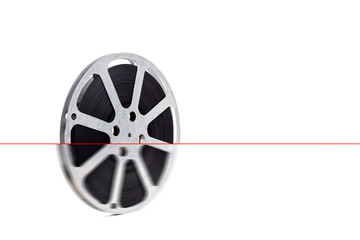 film reel on white background with color tape