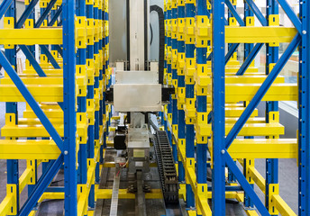 plastic boxes in the cells of the automated warehouse. Metal construction warehouse shelving