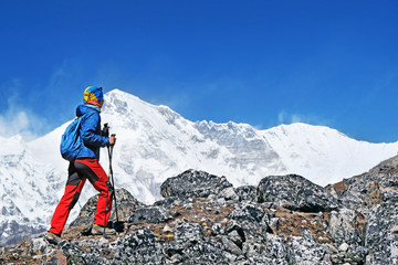 Hiker with backpacks in Himalayas mountain, Nepal. Active sport concept.