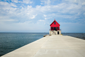 Lake Michigan Background. Long pier on the coast of Lake Michigan with the Grand Haven Lighthouse.