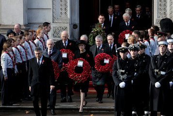 Britain's Prime Minister Theresa May and opposition Labour party leader Jeremy Corbyn are joined by other politicians as they arrive to attend a National Service of Remembrance, on Remembrance Sunday, at The Cenotaph in Westminster, London