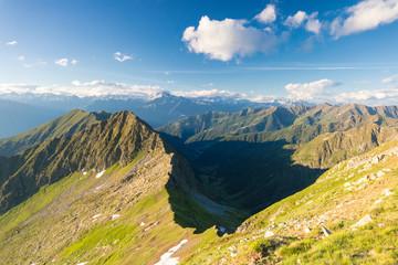 Rocky peaks of Monte Disgrazia and Monte Pedena seen from Monte Azzarini, Albaredo Valley, Orobie Alps, Lombardy, Italy