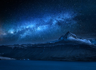 Fototapete - Milky way over volcanic mountain over fjord at night, Iceland