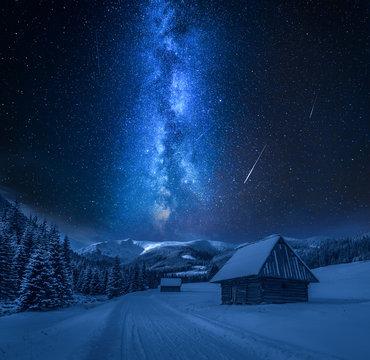 Milky way over snowy road at night, Tatra Mountains
