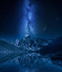 Fototapete - Milky way over mountains lake at night, Poland, Europe
