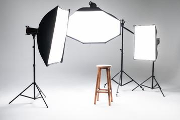Empty photo studio with lighting equipment. Photo staff.