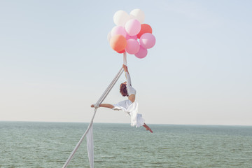 Young woman hovers in the air.
