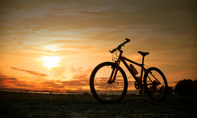 Silhouette bicycle with sunset or sunrise background