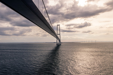 Big Belt Bridge from Funen to Sealand on a cloudy tranquil afternoon.Taken from the Color Line Fantasy which is a cruise ferry between Kiel and Oslo.