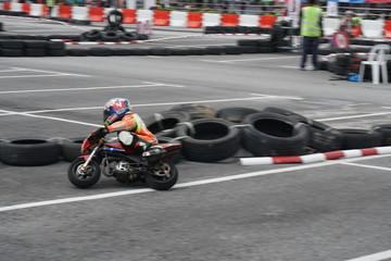 Mini-bike racing through the corner