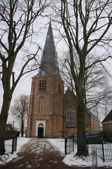 Old reformed church of the town Zevenhuizen in the snow during the winter