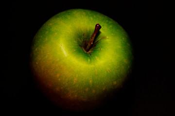 green apple on black background