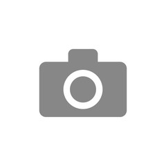 Gray photo camera icon. Vector illustration in flat design isolated on white background.