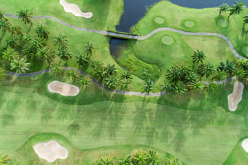 aerial view drone shot of beautiful green golf field.