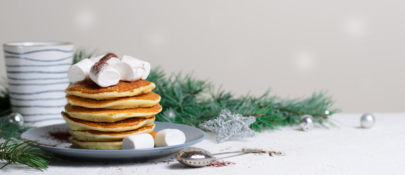 Pancakes with Marshmallow on Winter Background, Christmas Dessert