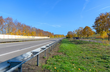 Freeway with crash barrier in autumn