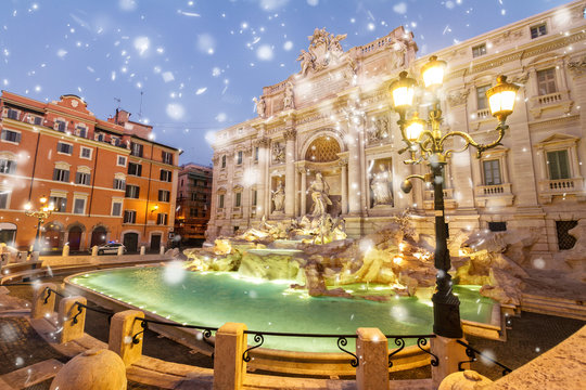 restored Fountain di Trevi in Rome with snow, Italy