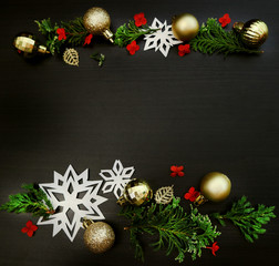 Christmas frame background. Christmas header with ornaments on dark wood.