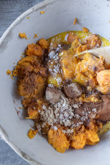 Mashed sweet potatos with brown sugar, egg, and spices in bowl