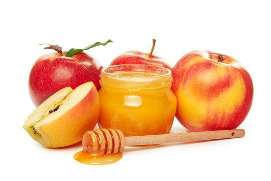 Apples and honey jar for jewish new year holiday isolated on white background