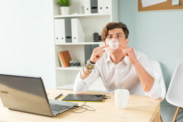 Joke, office, humor, people concept - handsome man chewing gum and thinking about something, huge bubble