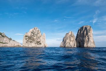 Sea stacks off the coast of Capri, Italy. They are named Stella, Faraglione di Mezzo with the arch, and Fraglione di Furori.