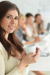 Portrait of young woman on coffee break