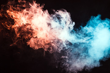Colored smoke on a black background. The concept of light show at a music concert
