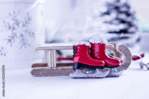 Christmas Background Decorative Wooden Sleds And Small Red Skates