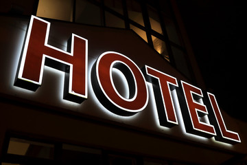 View of glowing hotel sign