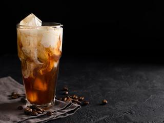 Obraz tall glass cold brew coffee with ice and milk on black or dark background - fototapety do salonu