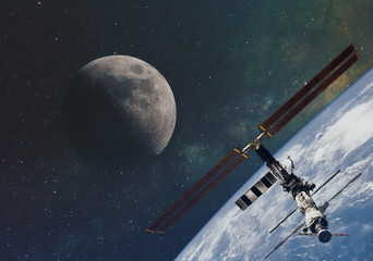 the moon against the milky way and the international space station in the infinite space of the universe in orbit of the earth. Elements of this image furnished by NASA