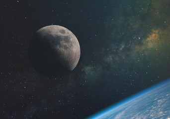the moon against the milky way and the rays of the sun in the infinite space of the universe in orbit of the earth. Elements of this image furnished by NASA