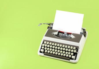 Vintage typewriter on color background