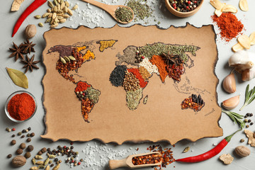 Stores photo Graine, aromate Paper with world map made of different aromatic spices on gray background, flat lay