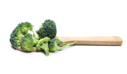 Fresh broccoli and wooden spoon isolated on white background