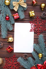 Christmas composition. Fir branches and christmas decor on a brown background
