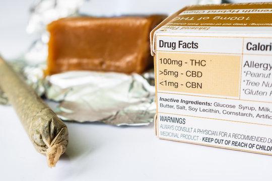 Marijuana Edible Infused Caramel Candy With Labeled Drug Facts & Marijuana Cigarette Up Close