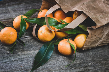 Ripe tangerines on the table. Tangerines in the package. Freshly picked