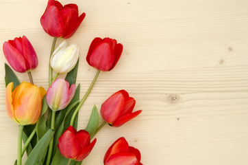 Tulips on a light wooden background. romantic picture.