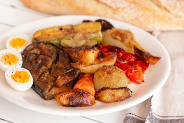 Grilled vegetables with hard boiled eggs.