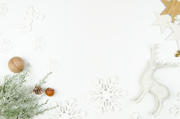 Merry Christmas frame mockup. Christmas deer, silver star and branches of a Christmas tree with cones.Flatlay mockup