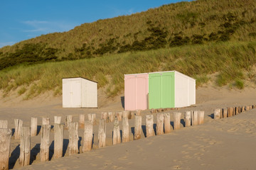 Pastel coloured beach cabins on the beach of Domburg, the Netherlands