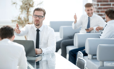 employees discussing new ideas in a modern office