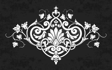 Decorative calligraphic floral ornament on chalkboard background