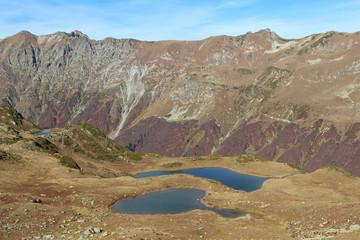 Panorama with yellow autumn hills, lakes and mountains. Abkhazia.